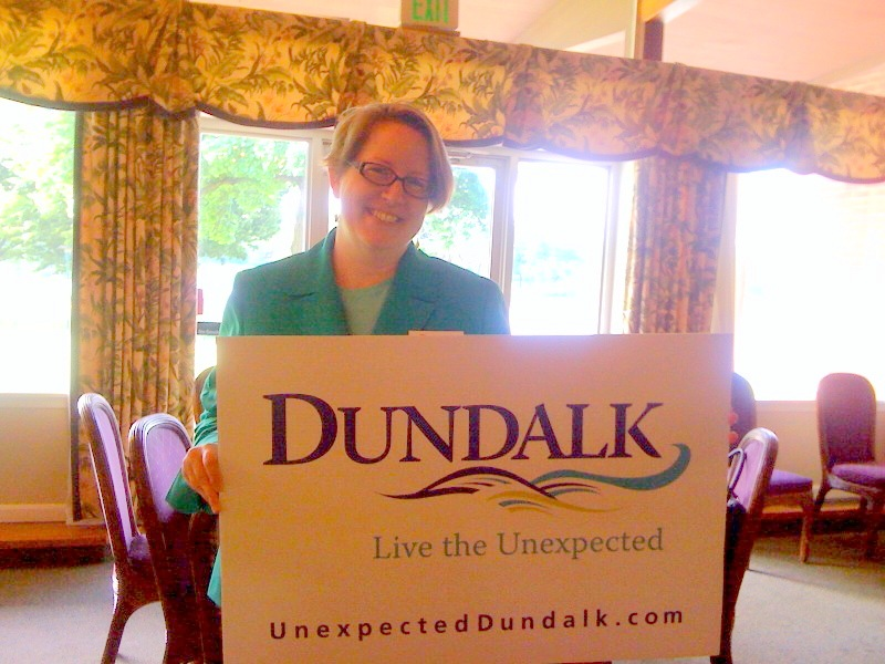 Amy Menzer, of the Dundalk Renaissance Corp., shows off the new logo and catchphrase. (Photo by Melody Simmons)