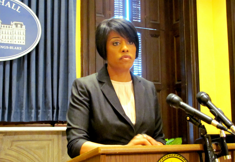 Mayor Rawlings-Blake responding to reporters' questions yesterday and (below) Sharon Pinder at a hearing before a City Council committee this morning. (Photos by Mark Reutter)