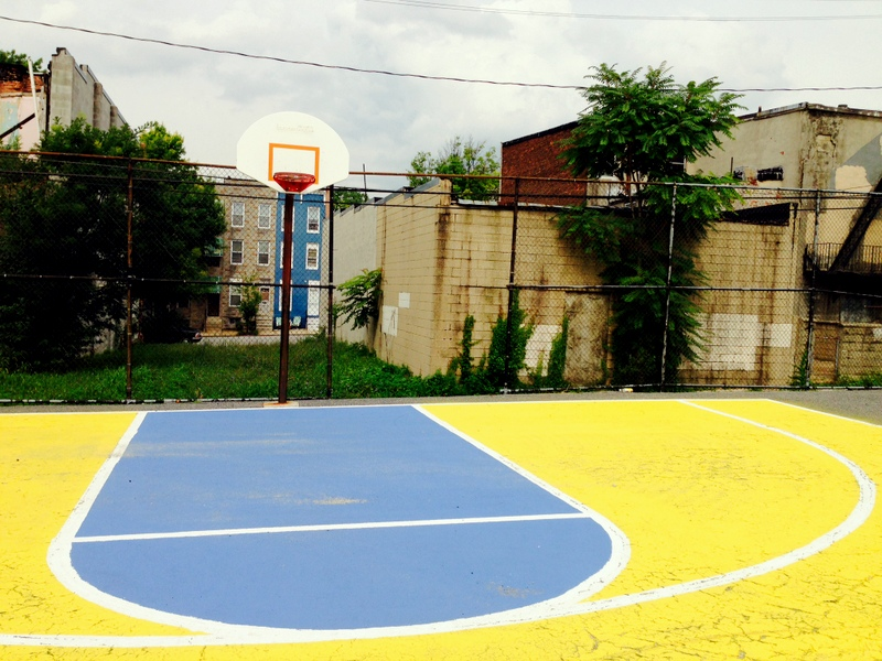 The basketball court, after volunteers painted it. (Photo by Danielle Sweeney)