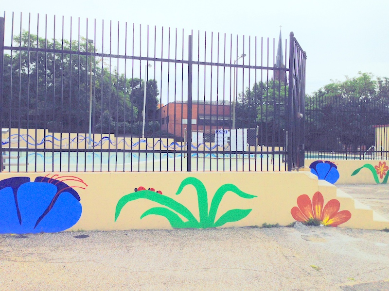 Pool and murals volunteers painted at Ambrose Kennedy. (Photo by Danielle Sweeney)