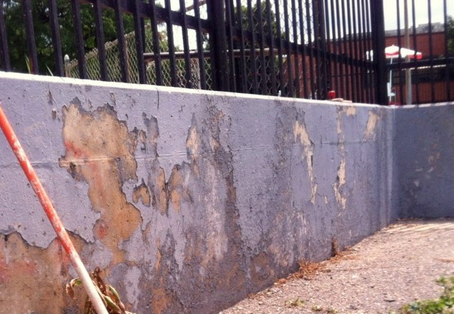 A 2013 photo of chipped paint on the pool wall has been that way for years, Williams says. (Photo courtesy BUILD)