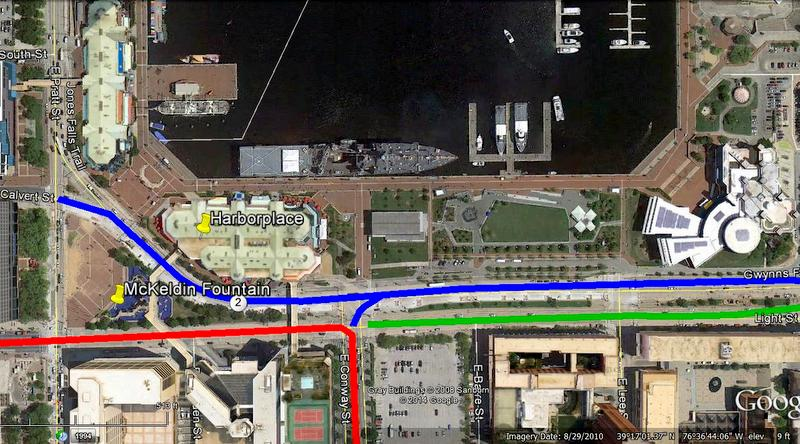 Three lines indicate proposed new traffic pattern. RED (Light to Conway through-street traffic) , BLUE (Calvert to  Light local traffic) and GREEN  (closed to street traffic).