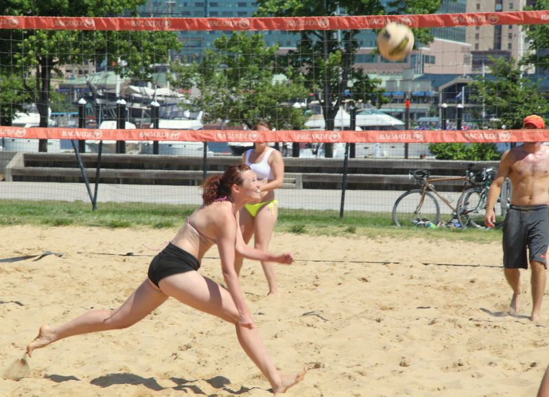 Under city plan, the south shore of the Inner Harbor would have the same relation to traffic (though Rash Field would sit higher, atop a parking gragae and no longer have beach volleyball.beach volleyball area. (Photo by Fern Shen)