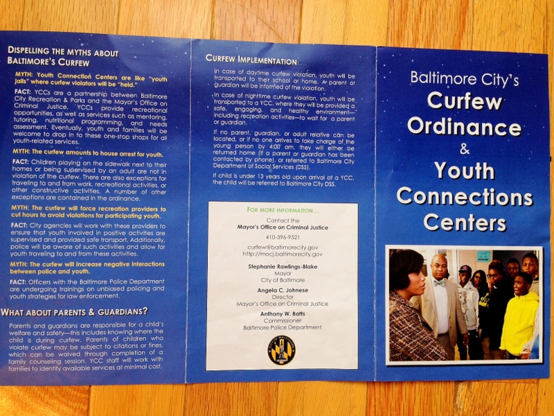 Information pamphlet prepared  by Baltimore city about new youth curfew/ 1/2 (Photo by Danielle Sweeney)