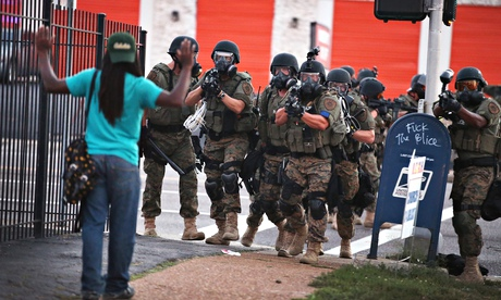 Police in Ferguson force protestors from the business district into nearby neighborhoods on Monday, August 11..  (Photo credit: Scott Olson/Getty Images)
