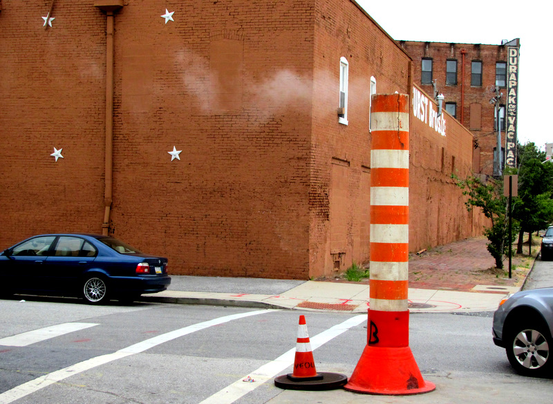 Venting steam stacks is a way of life in South Baltimore and downtown. Here steam rises from a removed manhole at Ostend and Leadenhall streets. (Photo by Mark Reutter)