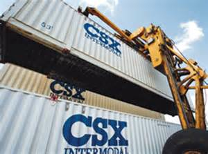 A machine double-stacking a container on a rail car. (Courtesy of CSX)