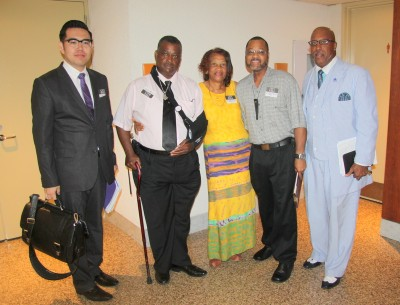 Attorney Kon Kim, left, with Robert Hunt, Mabel Gordon, Dewey Barksdale and Marvin