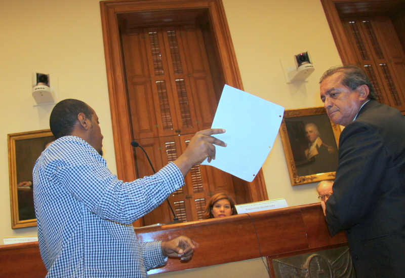 Yeneneh Hailu confronting Latin Palace licensee Jose Ribadeneira during Liquor Board hearing. (Photo by Fern Shen)