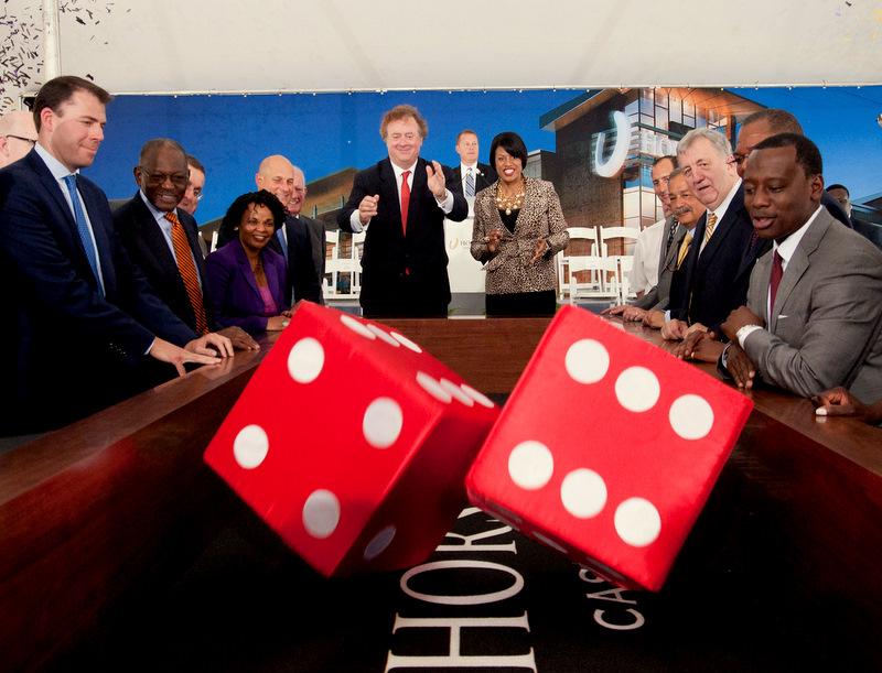 Entertainment Caesars CEO Gary Loveman and Mayor Rawlings-Blake roll a ceremonial set of dice to mark the groundbreaking of Horseshoe Baltimore. (Brew file photo)