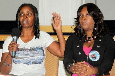 Darlene Cain and Twanda Jones, sister of Tyrone West, address the audience about experiences with the police. (Photo by Fern Shen)