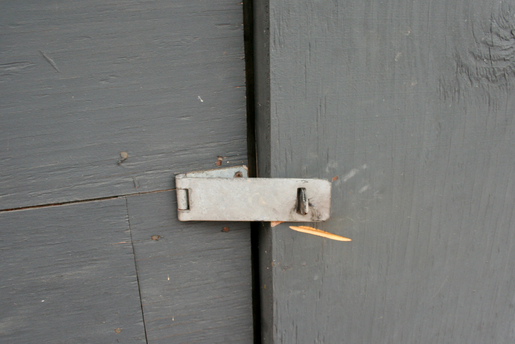 No padlock, so corner entrance door of 300 Franklin is open  to anyone who wants to enter. (Pholo by Danielle Sweeney)