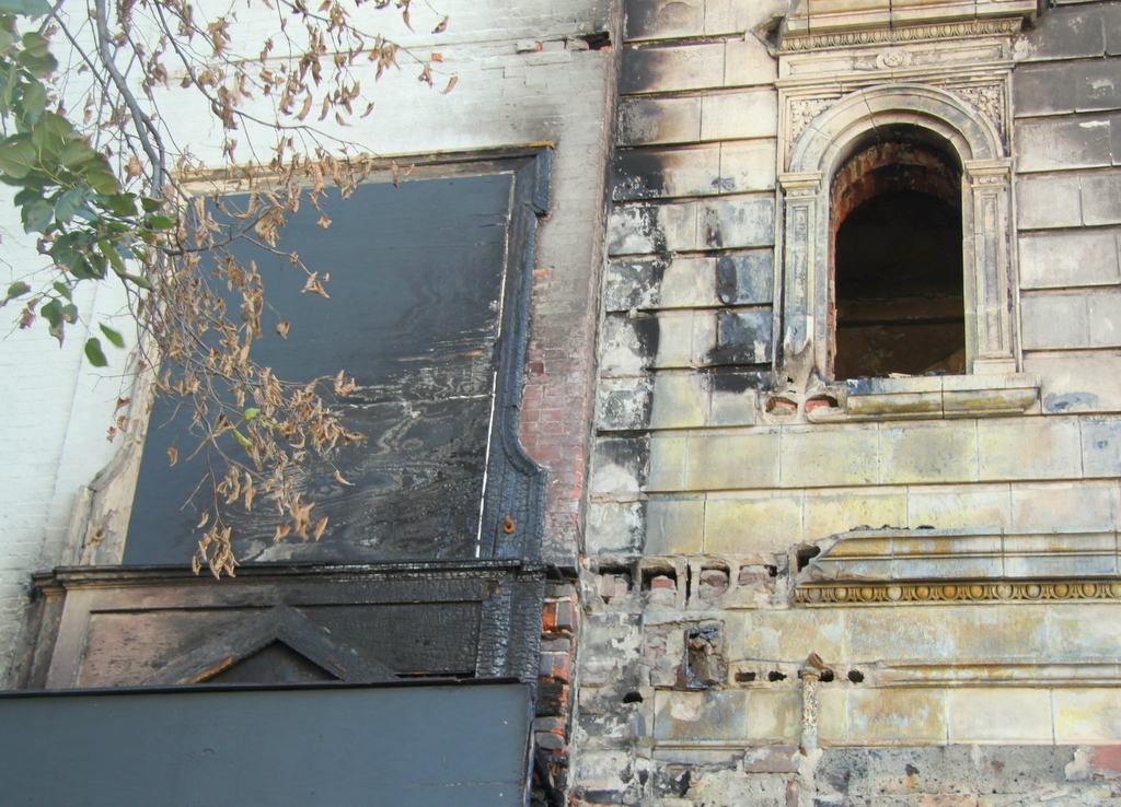 Fire damage to the Mayfair (right) can be seen from Howard Street. (Photo by Fern Shen)