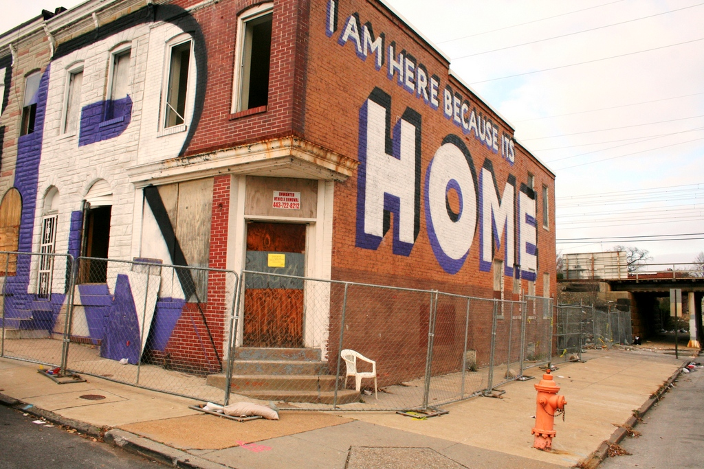 The eastern end of the Eager Street rowhouses being demolished, with Steve Powers mural. (Photo by Danielle Sweeney)