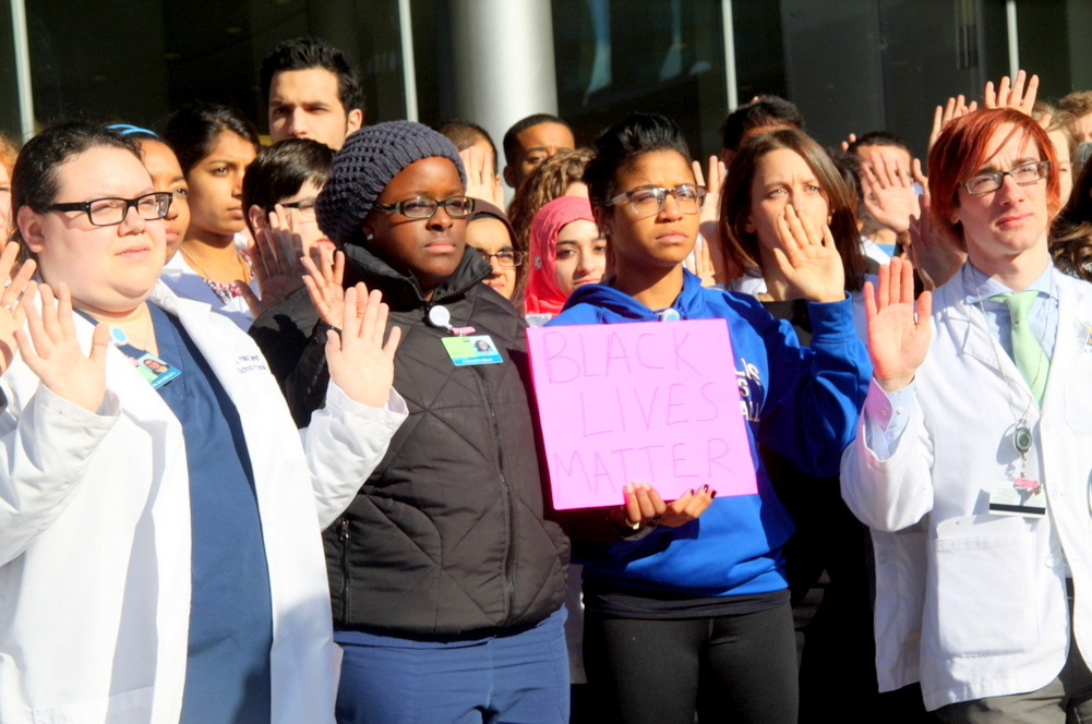 Hopkins medical students, nursing students, employees and others from the community participated in the protest. (Photo by Fern Shen)