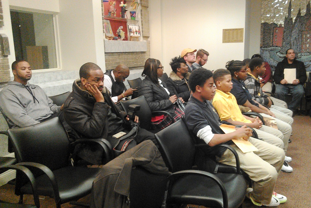 Supporters of Vanguard Collegiate Middle School listen to testimony. (Photo by Danielle Sweeney)