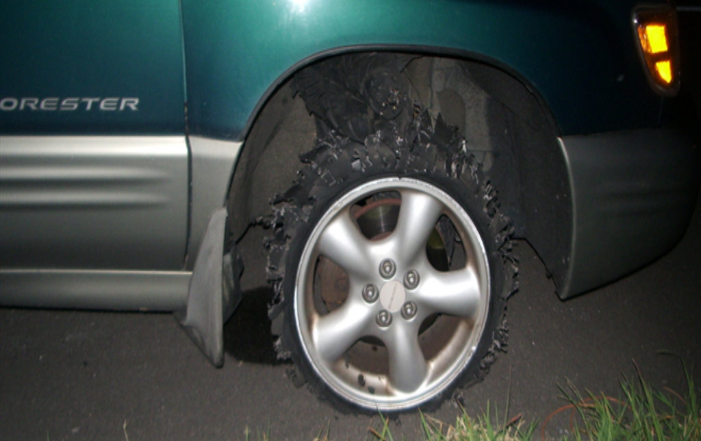 Shredded tire on the Subaru Forrester Heather Cook was driving when she was arrested in 2010.