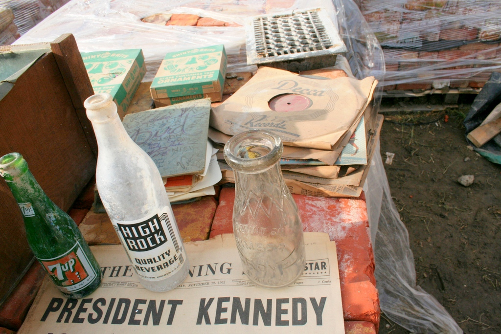 Objects found in the Eager Street rowhouses, from diaries and soda bottles to old 45's. (Photo by Danielle Sweeney)