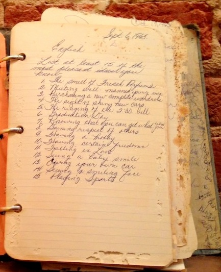 A schoolgirl's notebook, found in one of the houses. (Photo credit: baltimorebrickbybrick.com)