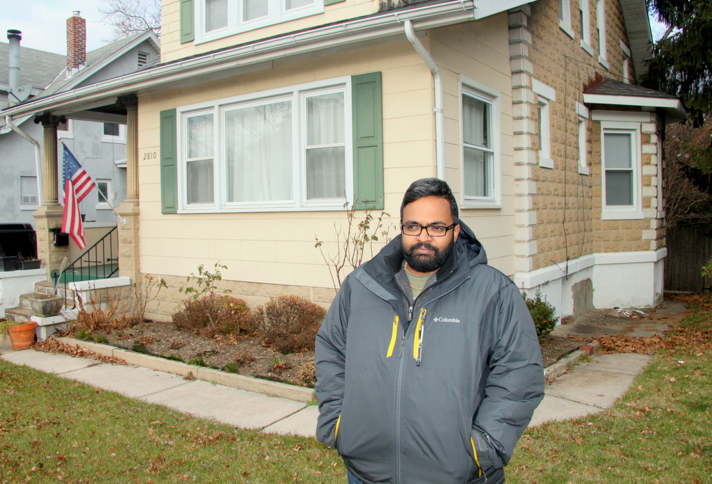 Joseph Daniel Talaiver said he's been complaining since the summer about problems behind the house next door to him. (Photo by Fern Shen)