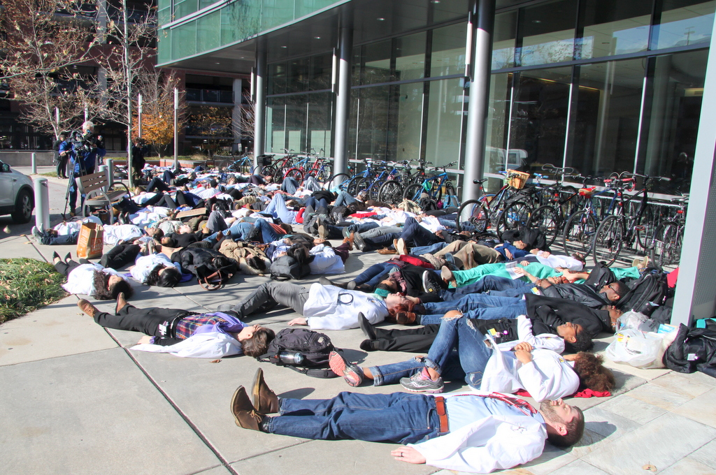 Medical students and others lay down outside Johns Hopkins Hospital to invoke the image of  unarmed black teenager  Michael Brown, whose body lay in the street for hours after he was shot by a white police officer in Ferguson, Missouri. (Photo by Fern Shen)