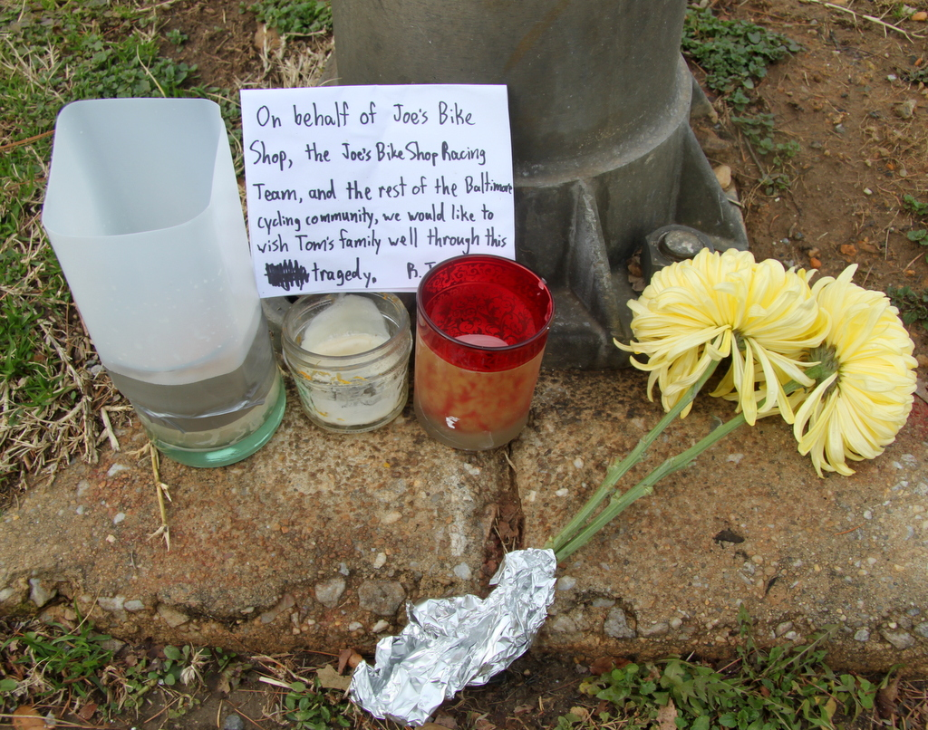 Notes and flowers from a candlelight vigil bicyclists held last night near the crash scene. (Photo by Fern Shen)