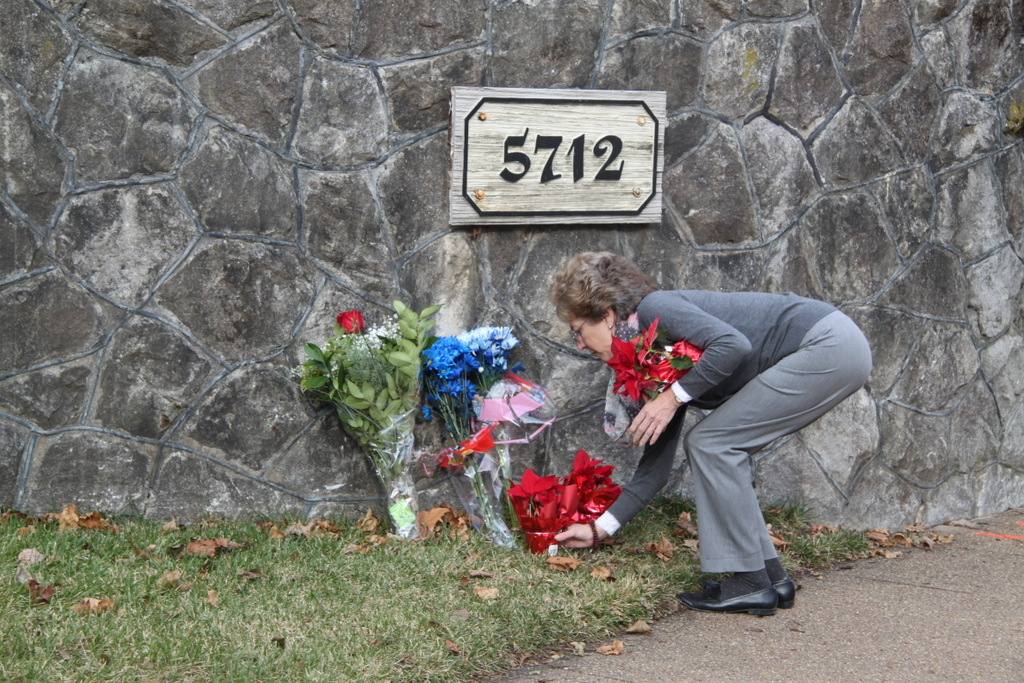 One of many people who came to leave flowers at the impromptu memorial for Tom Palermo yesterday. (photo by Fern Shen)