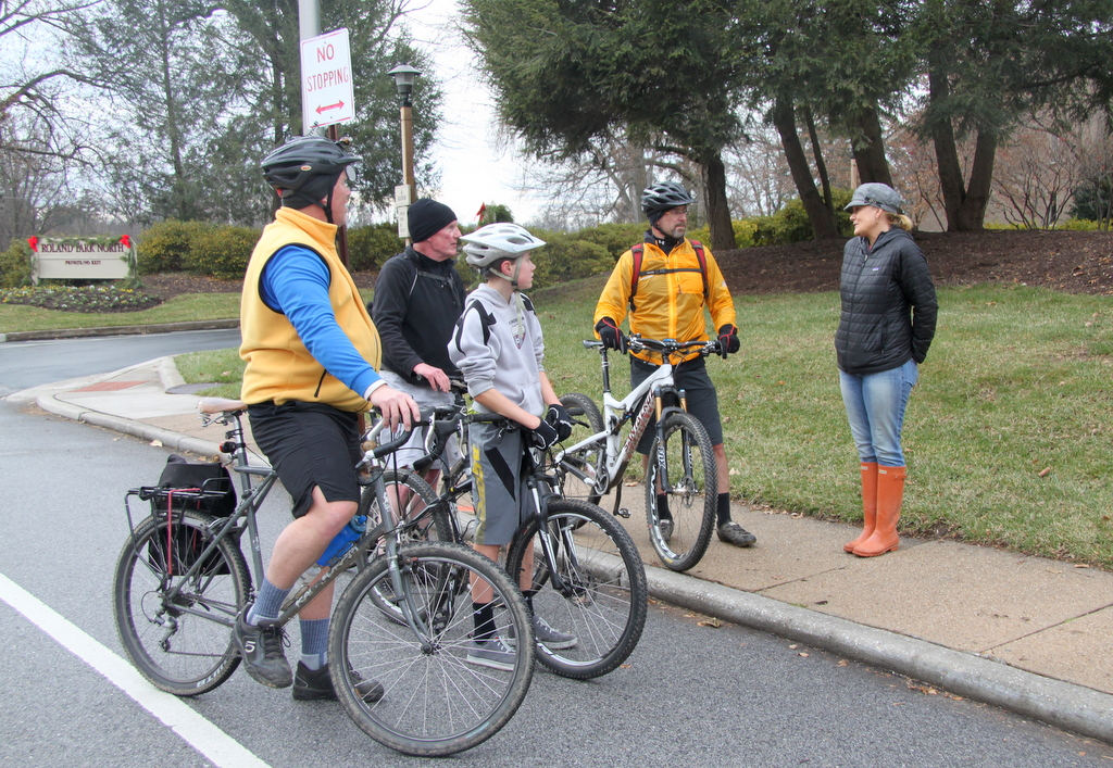 Bicyclists Scott McNary, Phil Kennedy, Ethan McNary and Bob Compton of Towson stopped at the scene on their way back from a ride downtown. (Photo by Fern Shen)