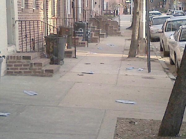 Copies of SunPLUS litter a South Baltimore Street. (Photo: @billcolebalt)