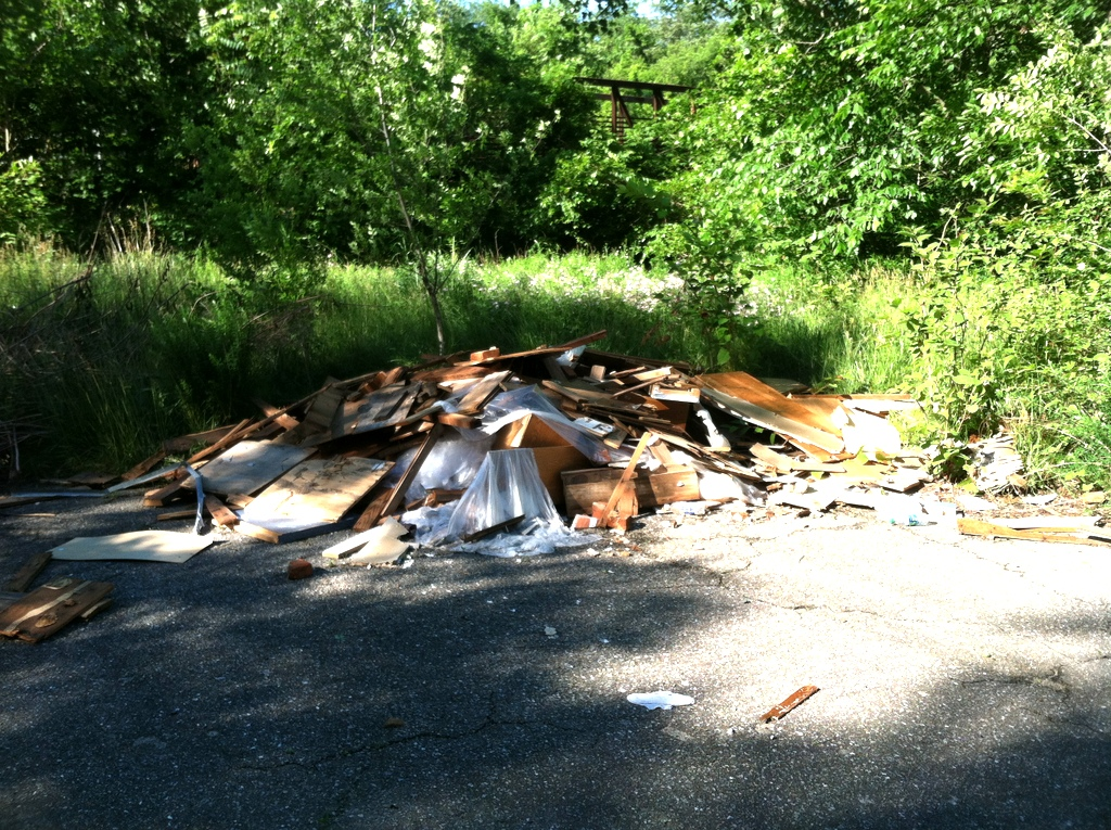 Construction debris dumped at the same location, and reported by Blue Water Baltimore, two years ago. (Photo by Blue Water Baltimore)
