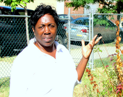 Betty Bland-Thomas at a vacant lot that's been restored into a community garden on Cross Street. (Photo by mark Reutter)