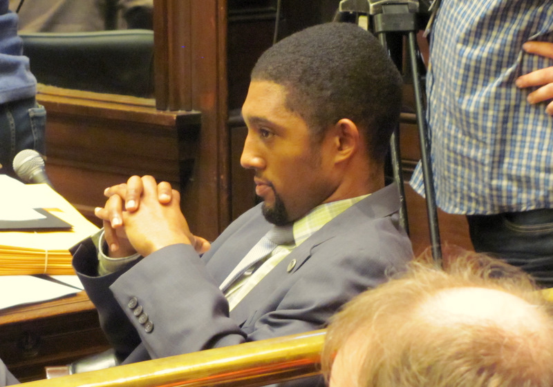Councilman Brandon Scott watches as his restaurant rating bill goes down in defeat.