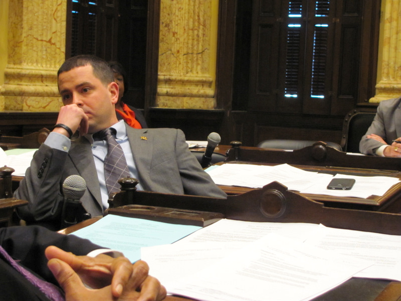 Eric Costello contemplates his restaurant bill vote last night. In foreground, the folded hands of Councilman Pete Welch. (Photo by Mark Reutter)