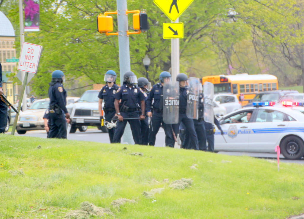 Police in the median, near Howard P. Rawlings Conservatory, visible at left. (Photo by Fern Shen)