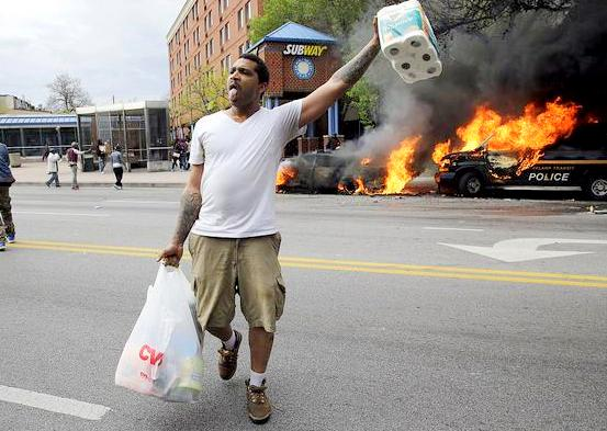 Looting in Baltimore this evening in the wake of the unexplained death of Freddie Gray. (AP)