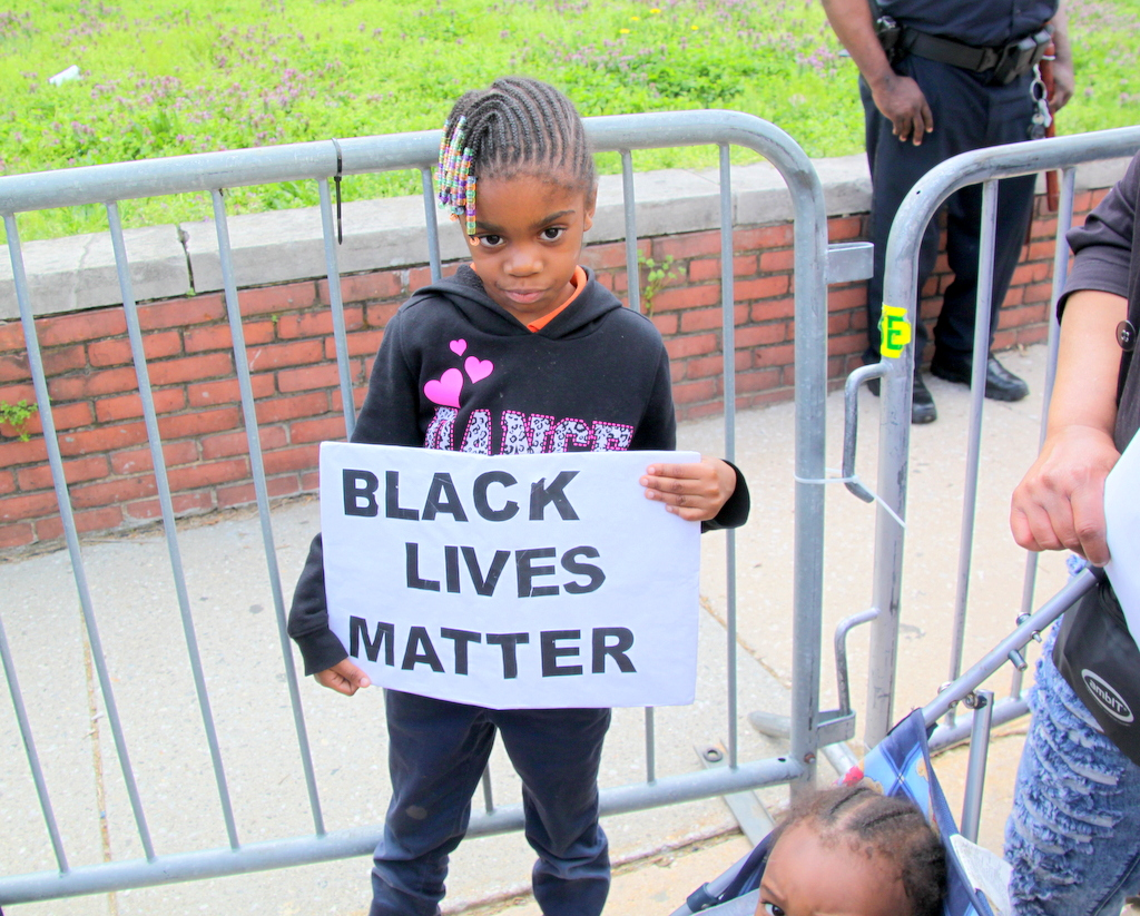 Trinay Woods, 6, who came to the protest with Freddie Gray's aunt, Teresa Zeigler.  (photo by Fern Shen)