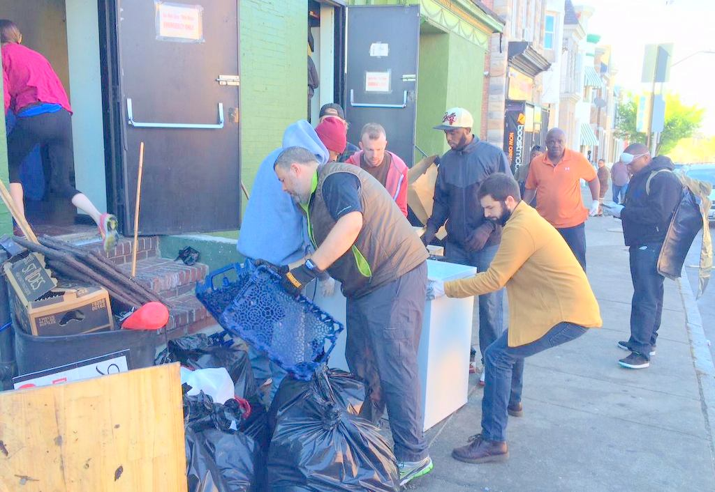 People showed up this morning to help the owner of the Oxford tavern clean up the mess after last night's looting. (Photo by Jim Burger)