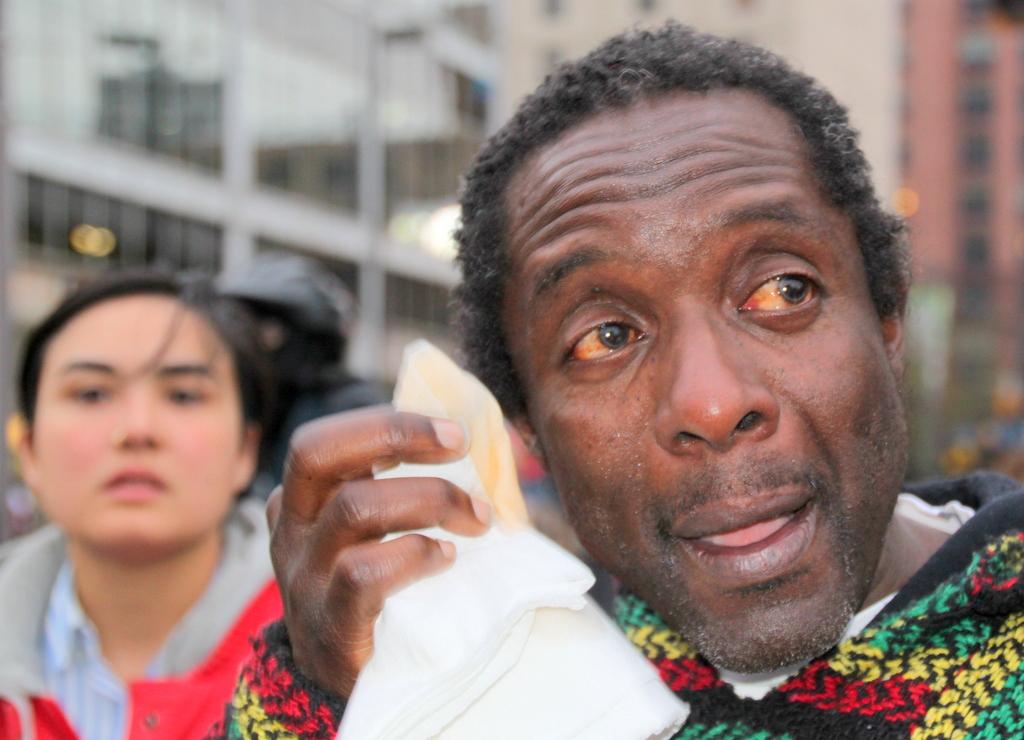 A demonstrator after being pepper sprayed. (Photo by Fern Shen)