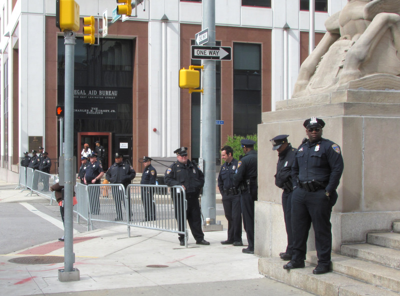 Still more police line up behind the barricade erected at Lexington and Gay streets. (Photo by Mark Reutter)