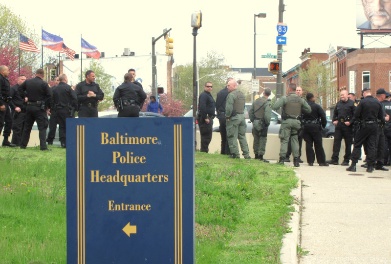 State Police and troopers from the Maryland Transportation Authority comingle with city police at Baltimore and President streets during the demonstration four blocks away. (Photo by Mark Reutter)