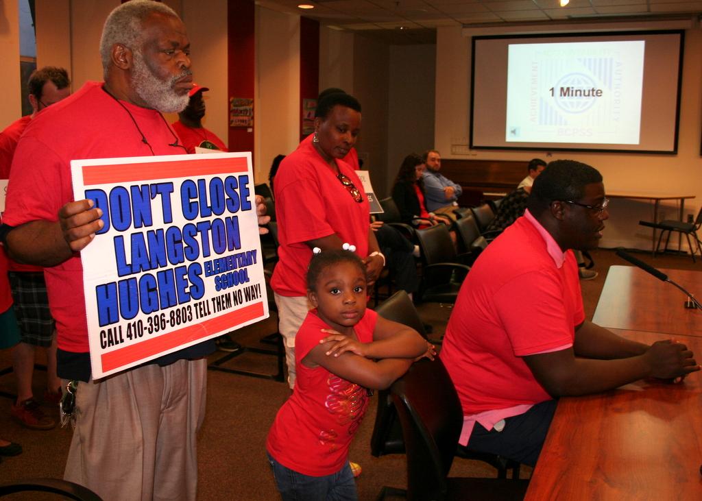 Steve Johnson, president of Garrison Hill Community Association in West Baltimore, tells the school board why Langston Hughes should remain open.