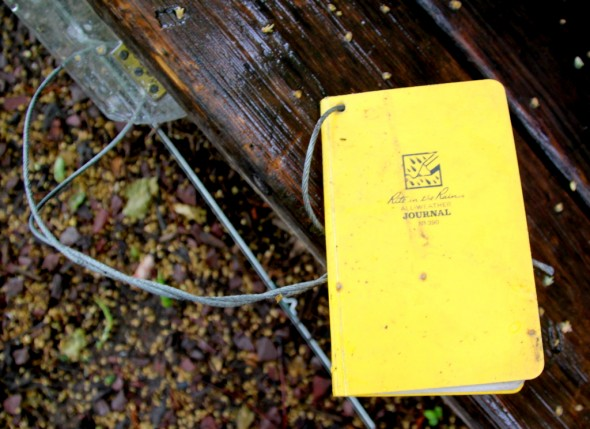 The yellow journals are attached to the benches with steel cables. (Photo by Fern Shen)