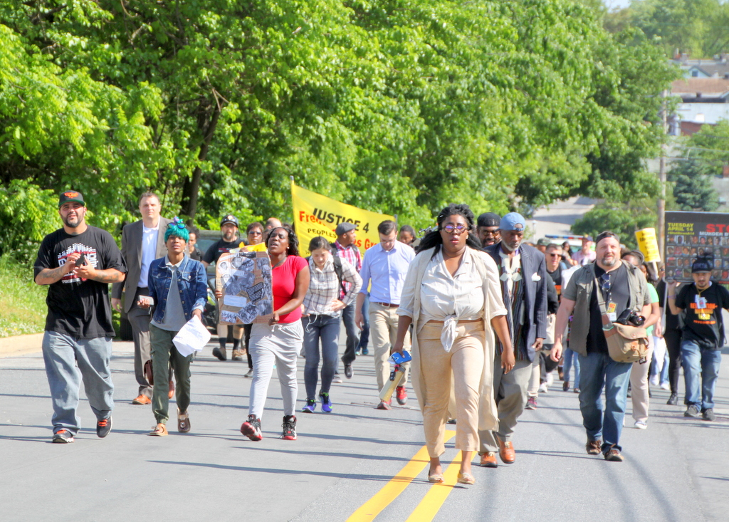 Protesters who walked from Giimor Homes in Sandtown arrive at police union headquarters in Hampden.  (Photo by Fern Shen)