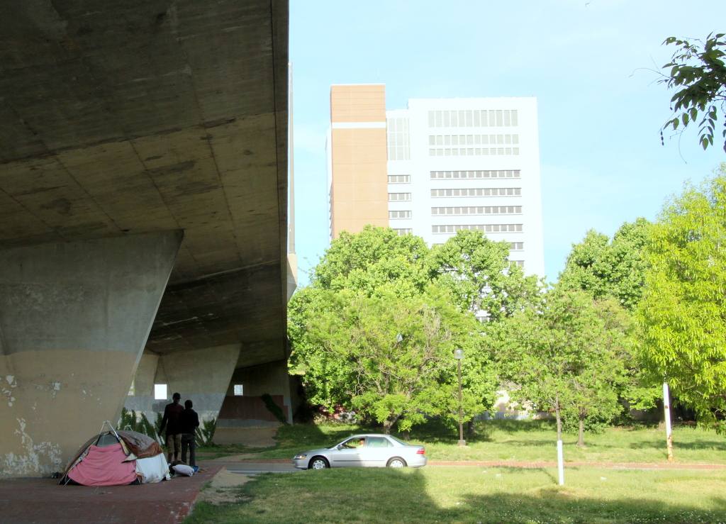 Homeless people live just west of the federal complex as the highway crosses over Martin Luther King Jr. Blvd. (Photo by Fern Shen)