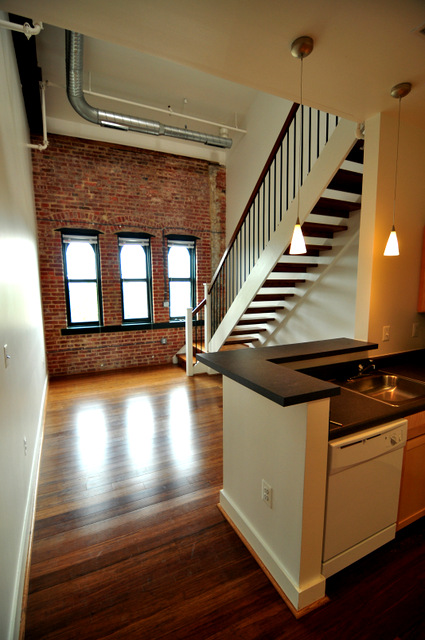 Roomy loft living at the ex- tin plate manufacturing plant. (Photo courtesy of Seawall Development Co.)