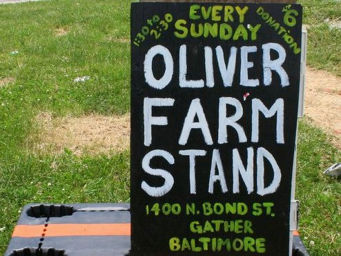 Sign for Oliver Farm Stand at 1400 North Bond Street in Oliver. (Photo by Danielle Sweeney)