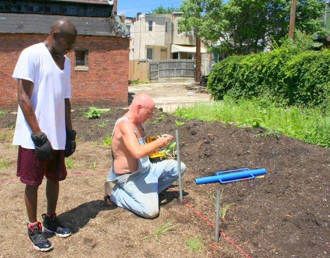 Arthur Morgan and Mike working on the site of the future community garden. (Photo by Danielle Sweeney)