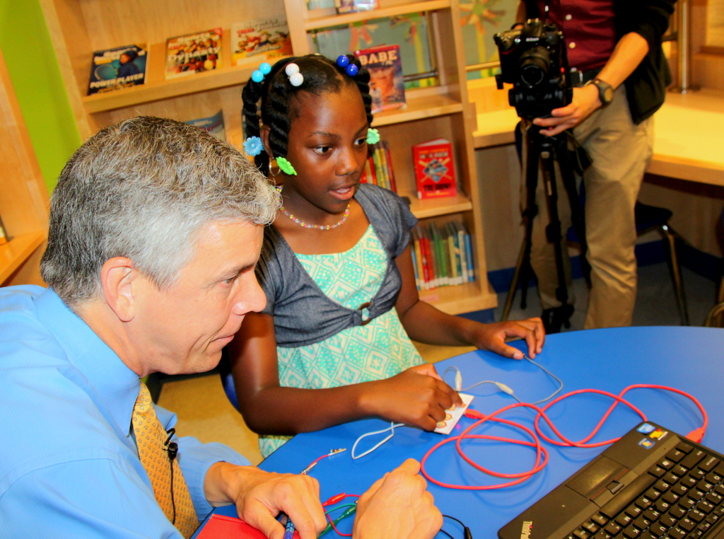 At Baltimore's Liberty Elementary School, Amanda Thompson shows Education Secretary Arne Duncan her work.