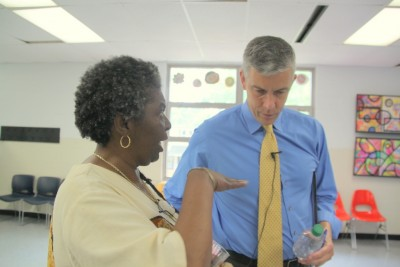 Kim Trueheart speaks with Education Secretary Duncan following his tour of Liberty Elementary School. (Photo by Fern Shen).
