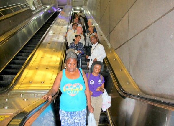 Dixon and others on Charles Center station escalator. (Photo by Fern Shen)